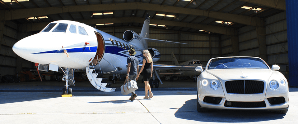 Man and woman entering private jet.