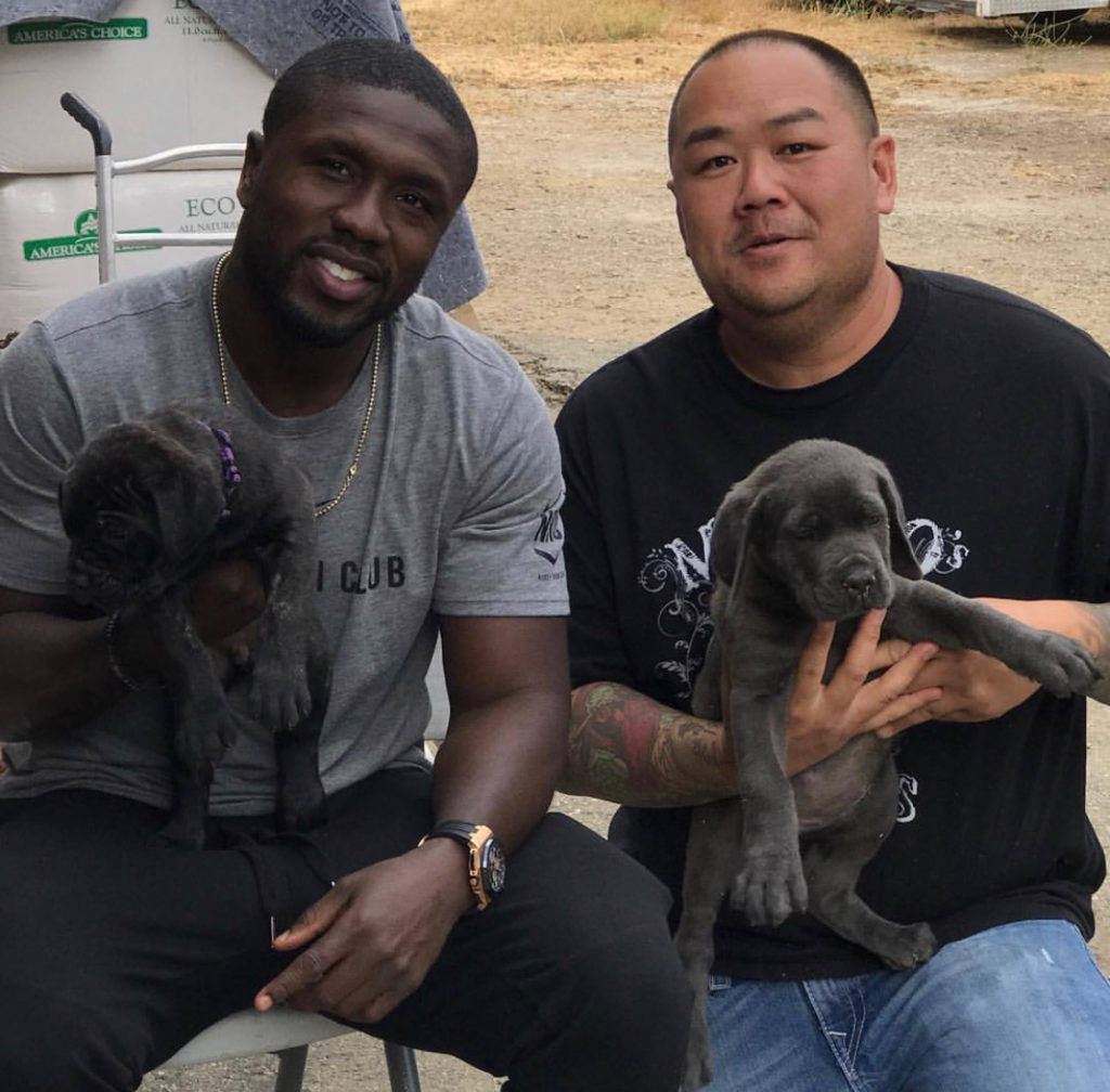Maximos Kennels customers with two puppies.